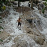 Climbiing down Dunns River Falls solo. Bond and Honey spend time at the foot of the falls